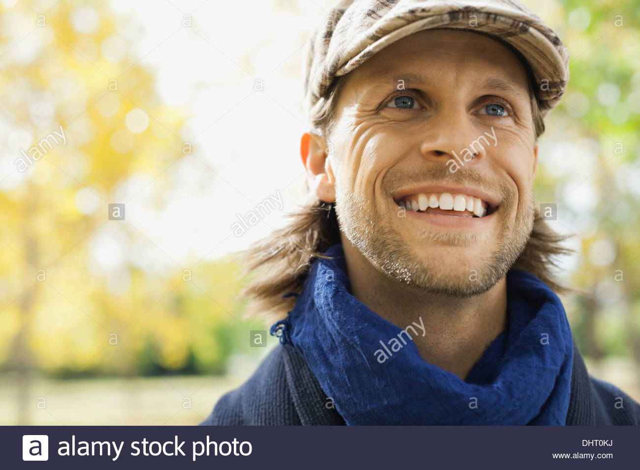 Close-up of happy man at park - Stock Image