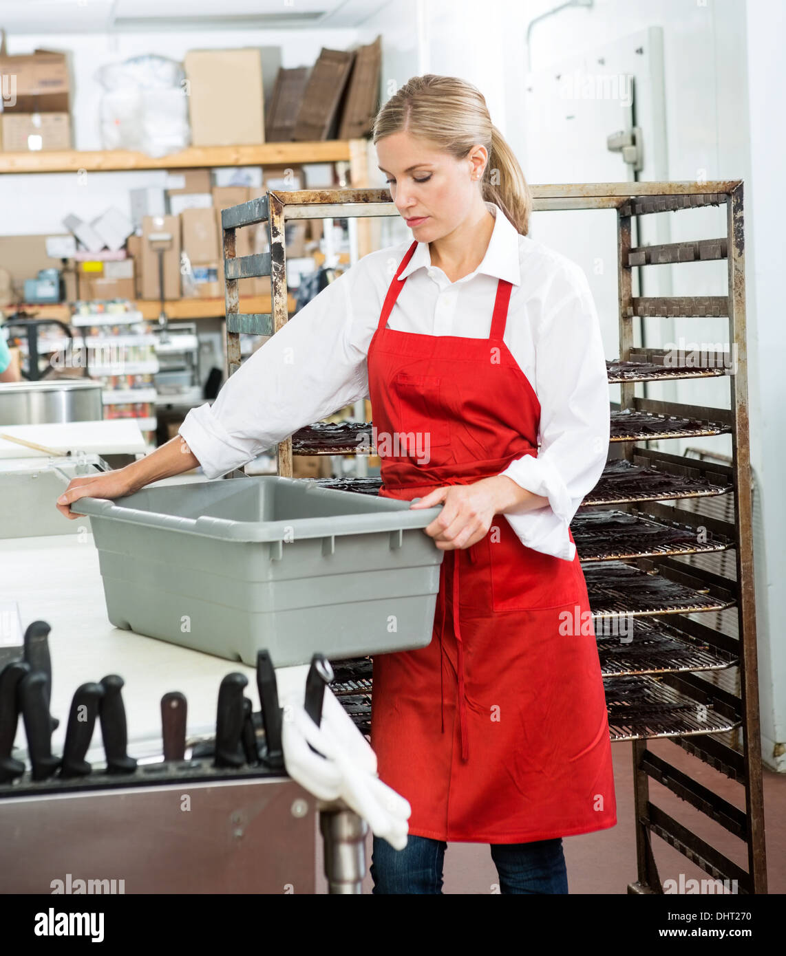 Worker Carrying Basket At Butcher's Shop - Stock Image