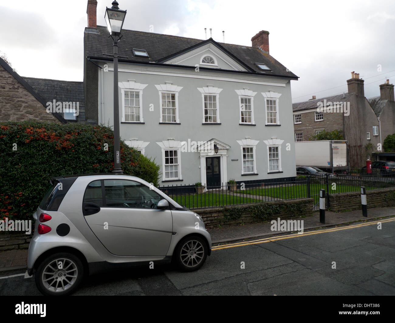 Silver Smart Car parked in front of Ivy Towers Grade II listed building in Crickhowell, Powys, Wales UK  KATHY DEWITT Stock Photo