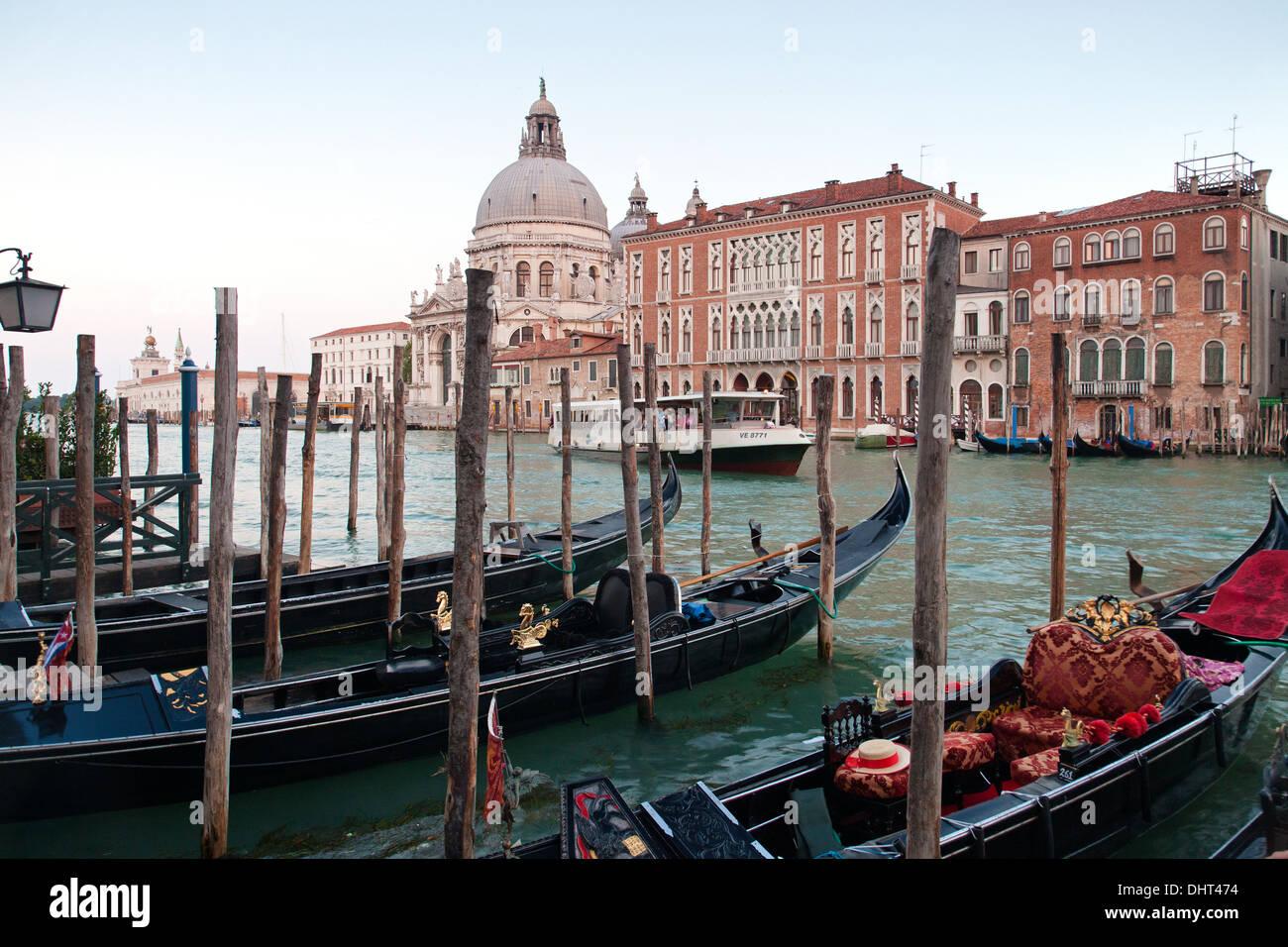 Gondolas on the Grand Canal and view to the church of Santa Maria della Salute, Venice, Italy - Stock Image