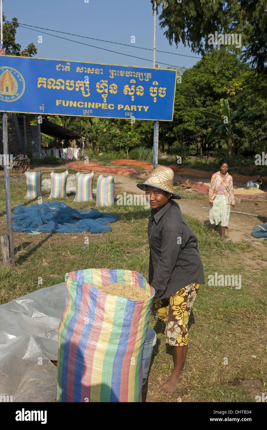 Farmer with a bulging rice bag, Cambodia Stock Photo