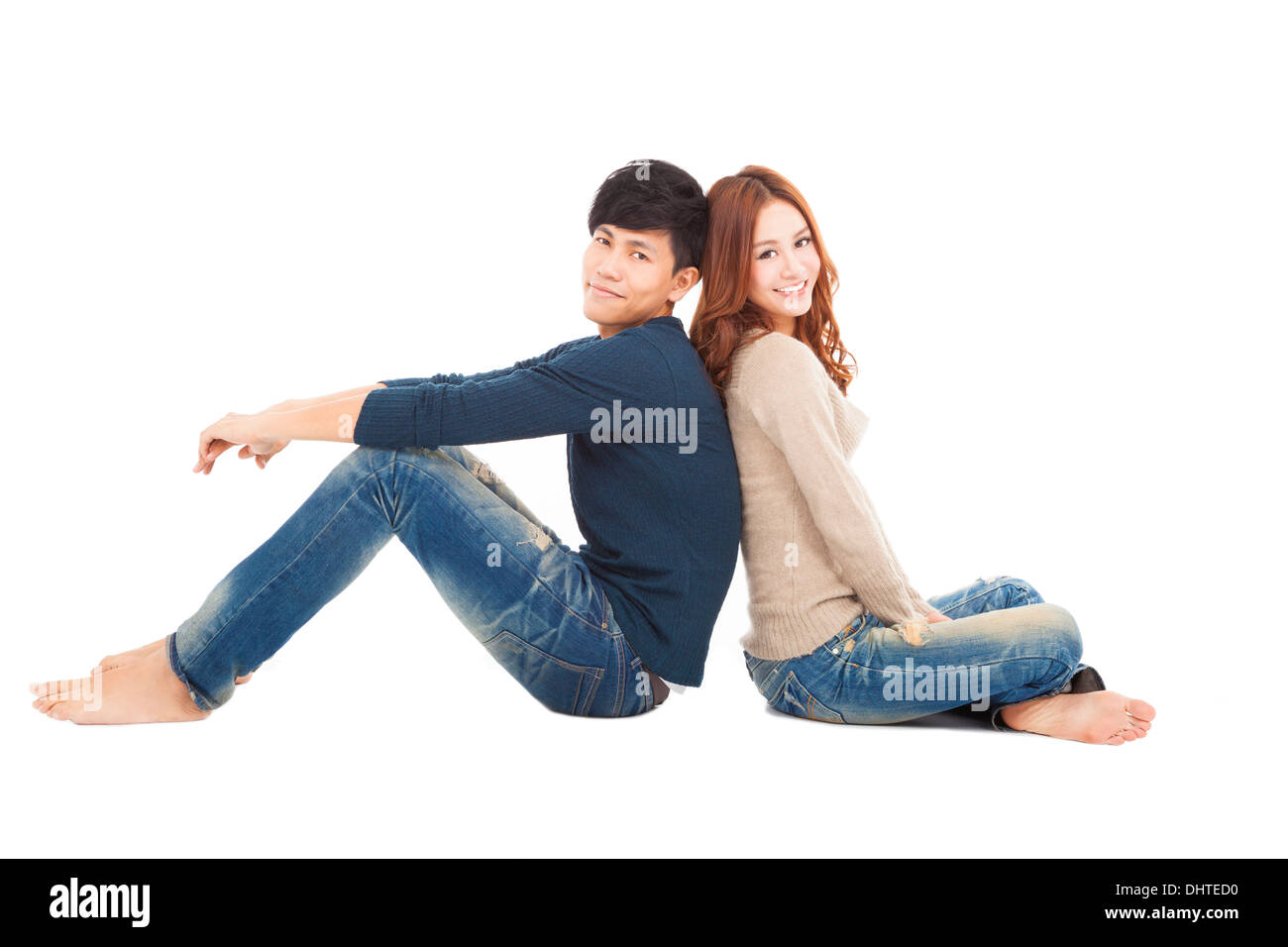 young couple sitting together - Stock Image