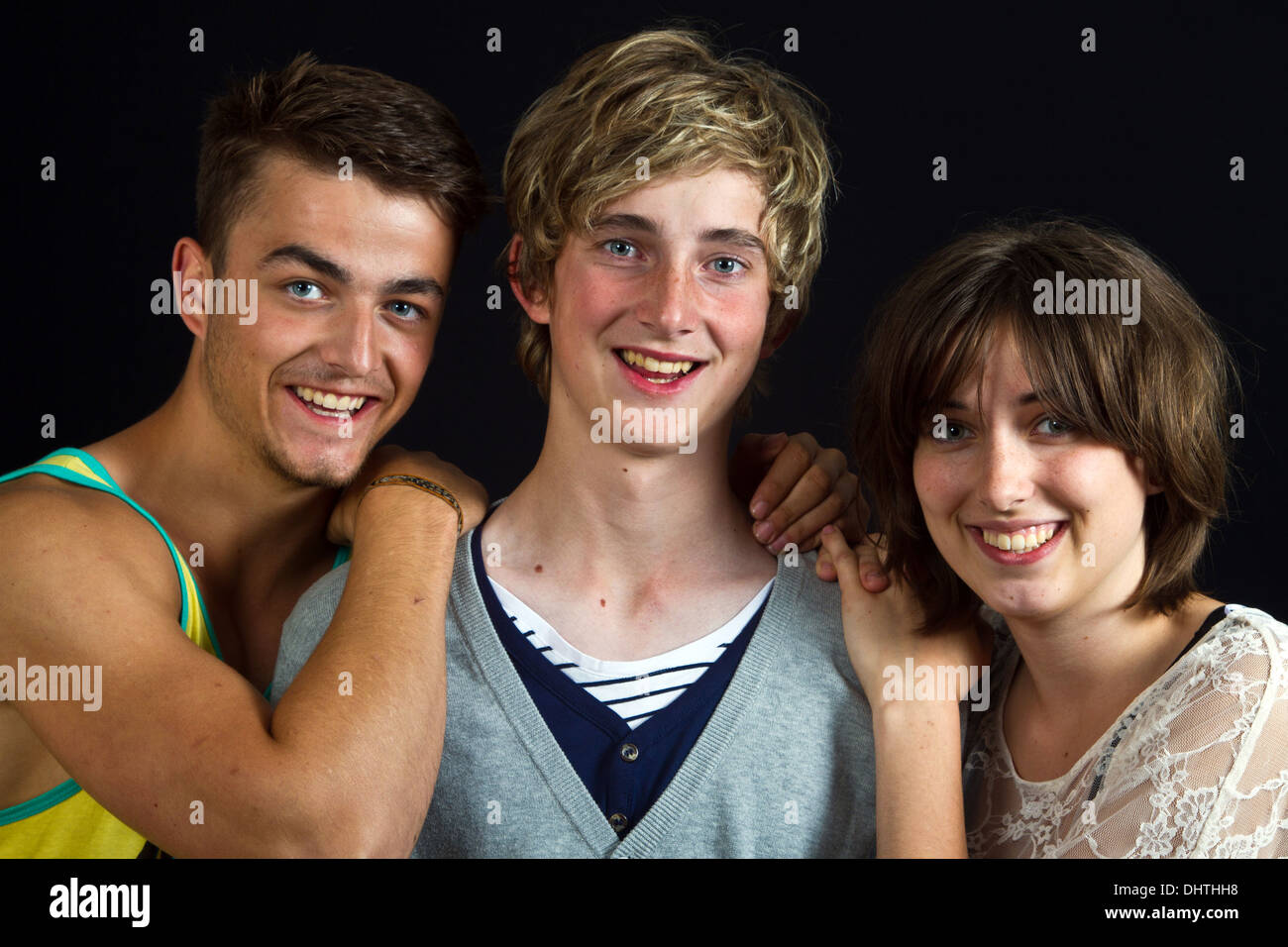 Brothers and sister, portrait of a young Scandinavians in studio - Stock Image