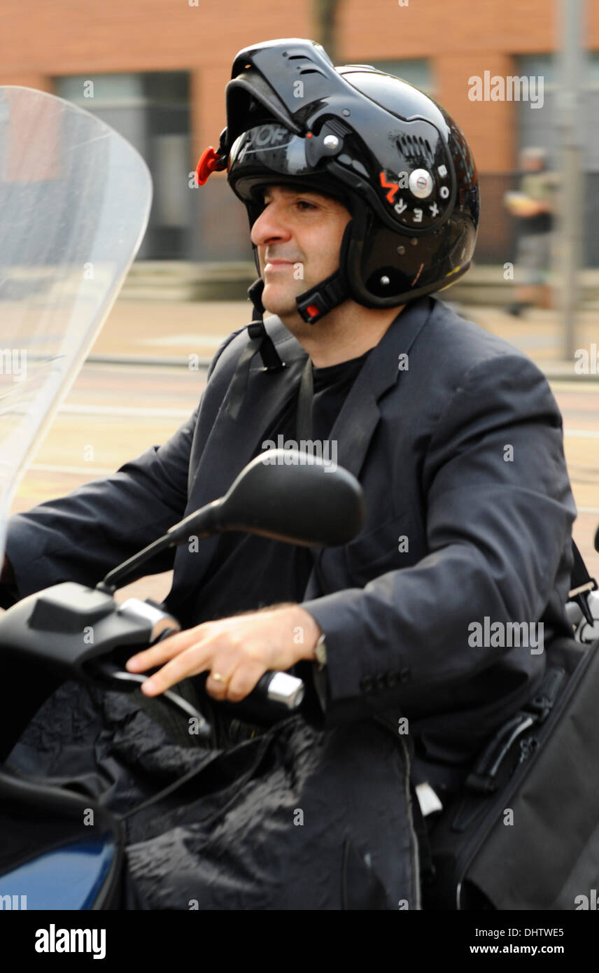 Omid Djalili arrives at the ITV studios on an MP3 Scooter London, England - 24.05.12 - Stock Image