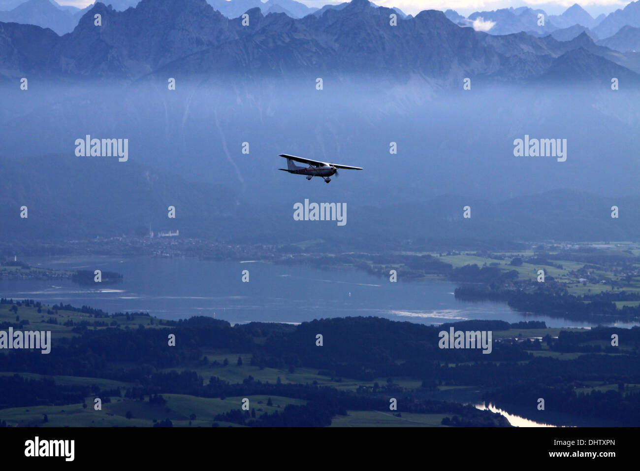 sports aeroplane over the Forggensee - Stock Image