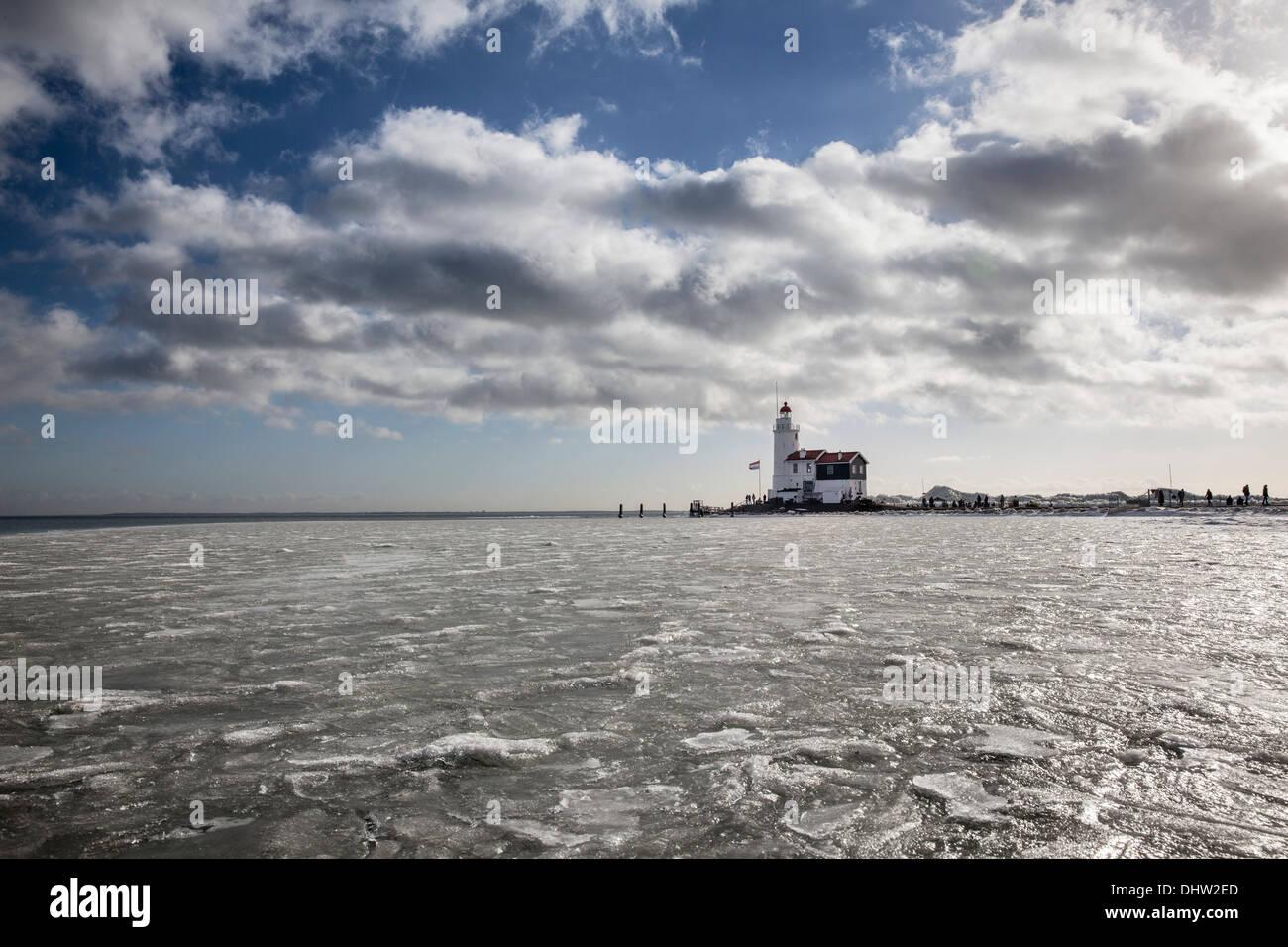 Netherlands, Marken, Lake called IJsselmeer. Winter. Lighthouse called Het Paard - Stock Image