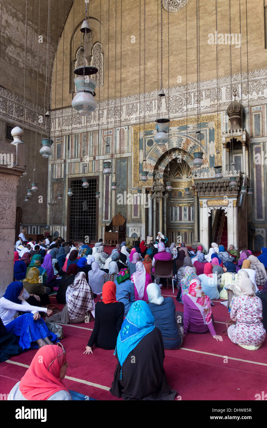 Cairo, Egypt . 15th Nov, 2013. Muslims listen to sermon before Friday prayers in the Mamluk mosque of Sultan Hasan. - Stock Image
