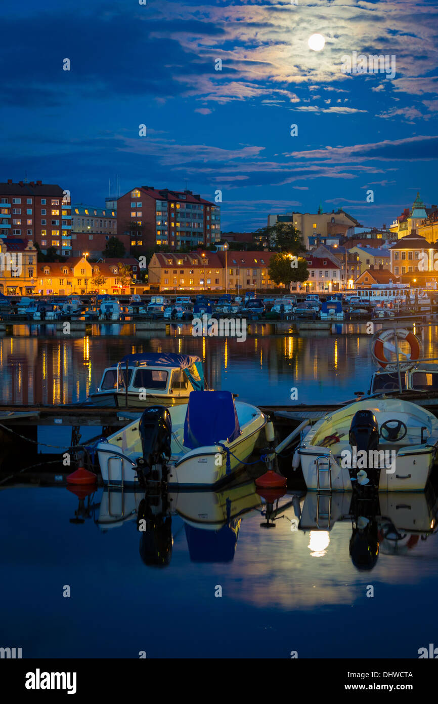 Moonrise over small boat marina in Karlskrona, Sweden - Stock Image