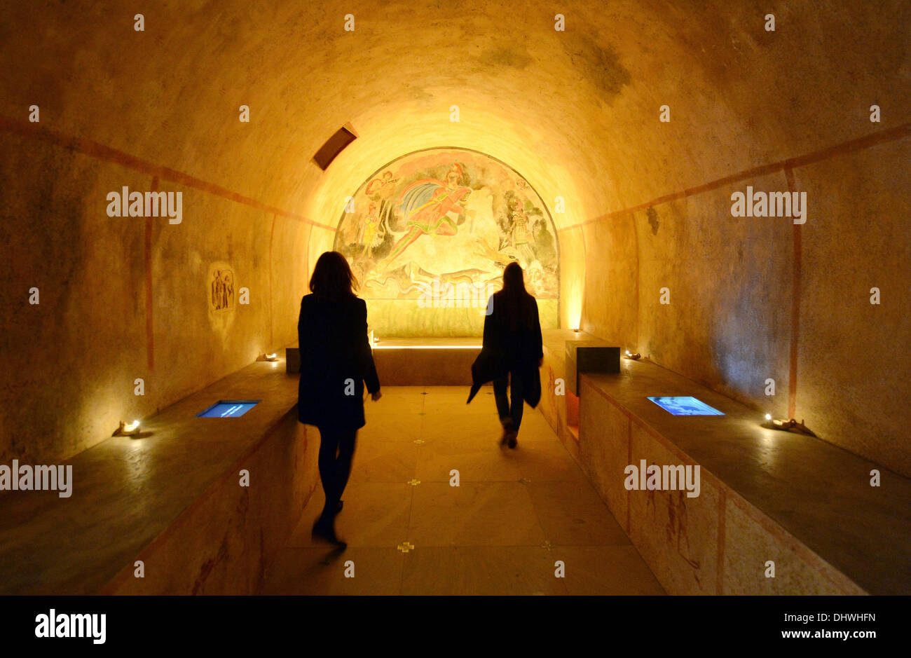 Karlsruhe, Germany. 14th Nov, 2013. Visitors of the Baden State Museum in the castle Karlsruhe look at the replication of the mithraeum of Santa Maria Capua Vetere in Karlsruhe, Germany, 14 November 2013. It is part of the exhibition 'Empire of the Gods - Mithras - Christ: cults and religion in the Roman Empire' which takes place from 16 November 2013 to 18 May 2014. Photo: Uli Deck/dpa/Alamy Live News - Stock Image