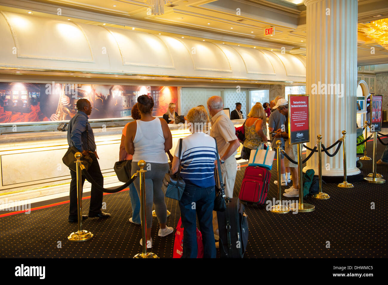 USA America New Jersey NJ N.J. Atlantic City line to check in at the Atlantic Club Casino Hotel tourists holiday checking - Stock Image