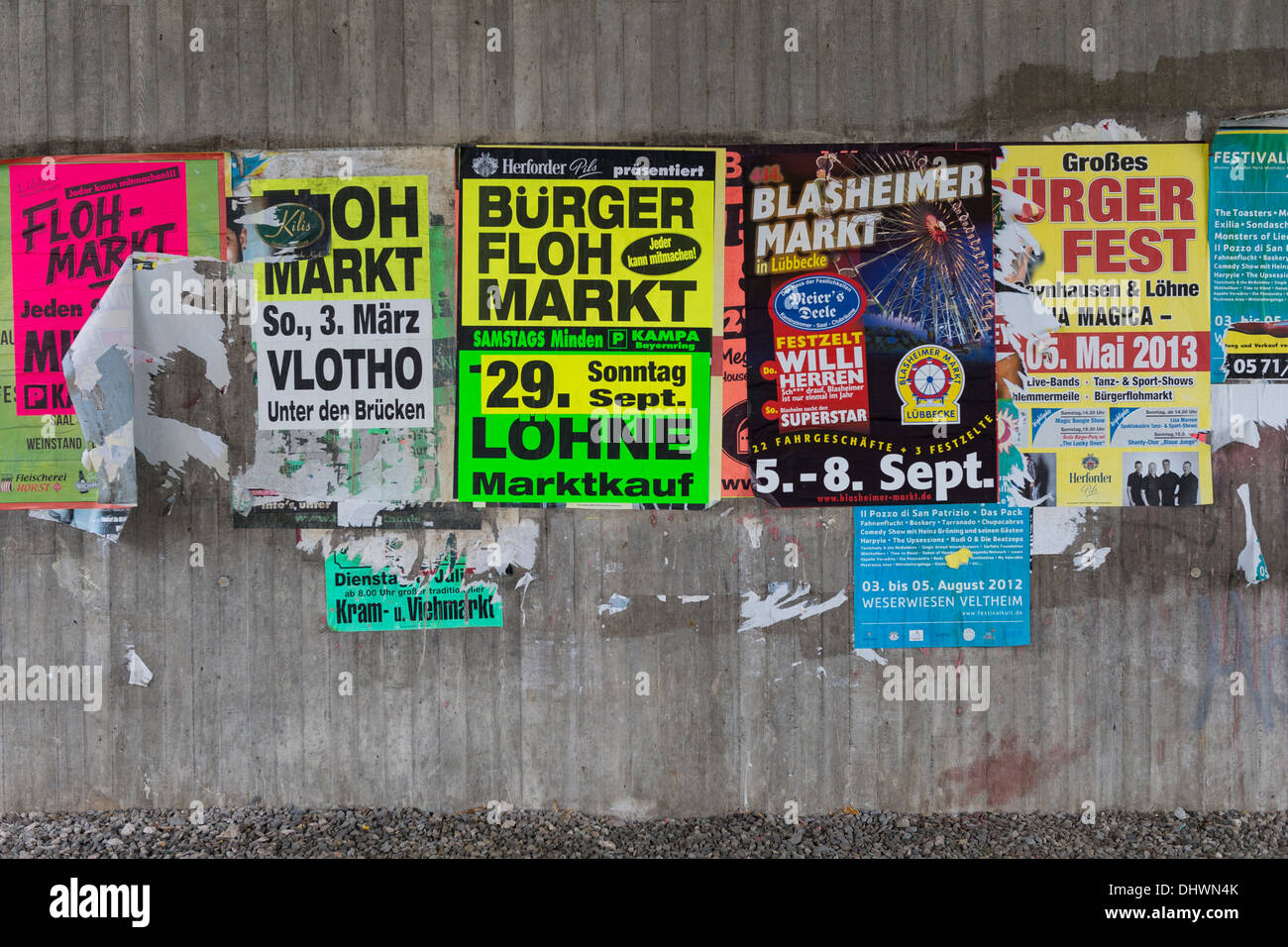 Bill Posters in German on Underpass Wall - Stock Image