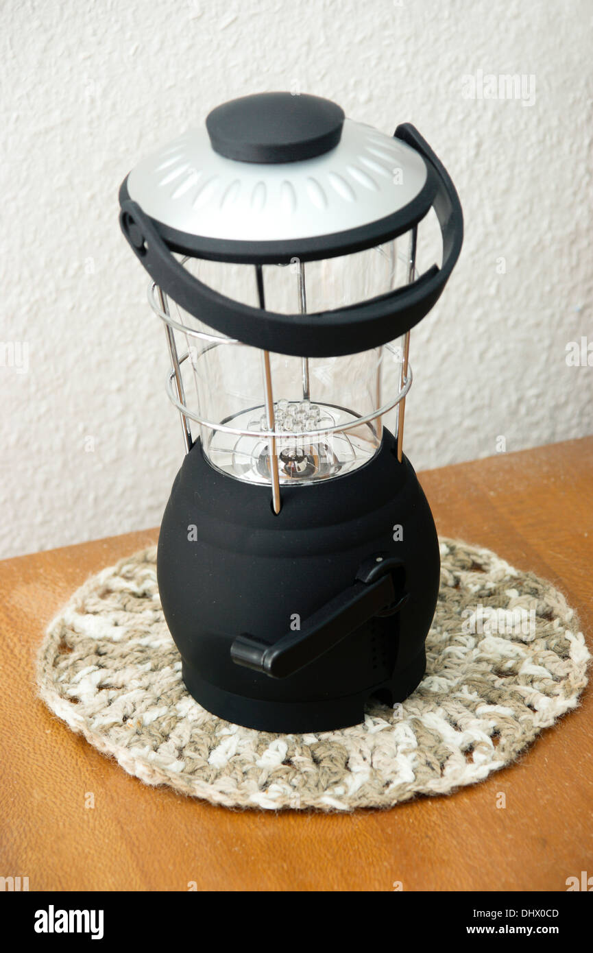 A wind up lantern lamp used for emergency lighting for power cuts power failures & running out of electricity power - Stock Image