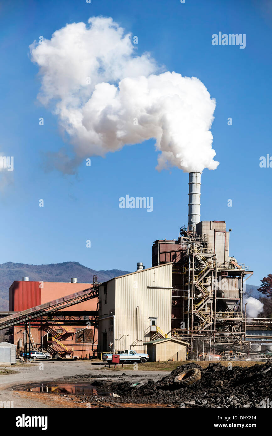 Jackson Paper Manufacturing plant with smoke stack in the Smoky Mountains in Sylva, North Carolina recycles paper products. - Stock Image