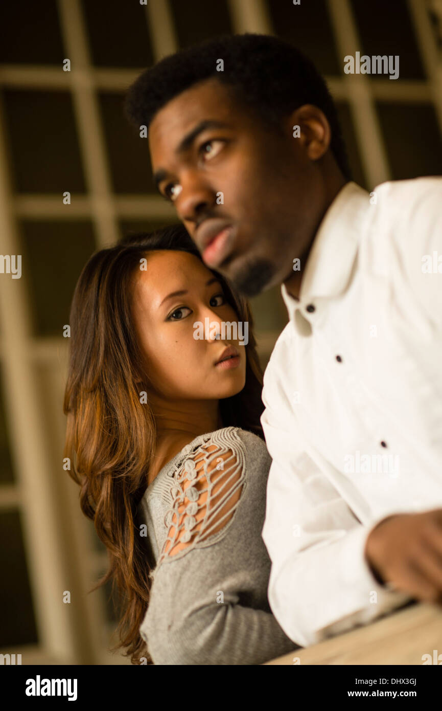 a young couple asiatic chinese woman afro caribbean black man