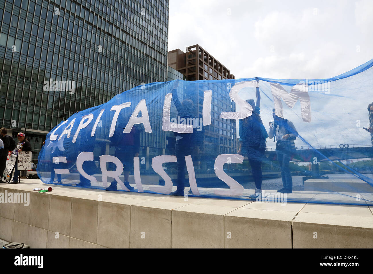 Anti-G8 activists rally in London banking district. - Stock Image