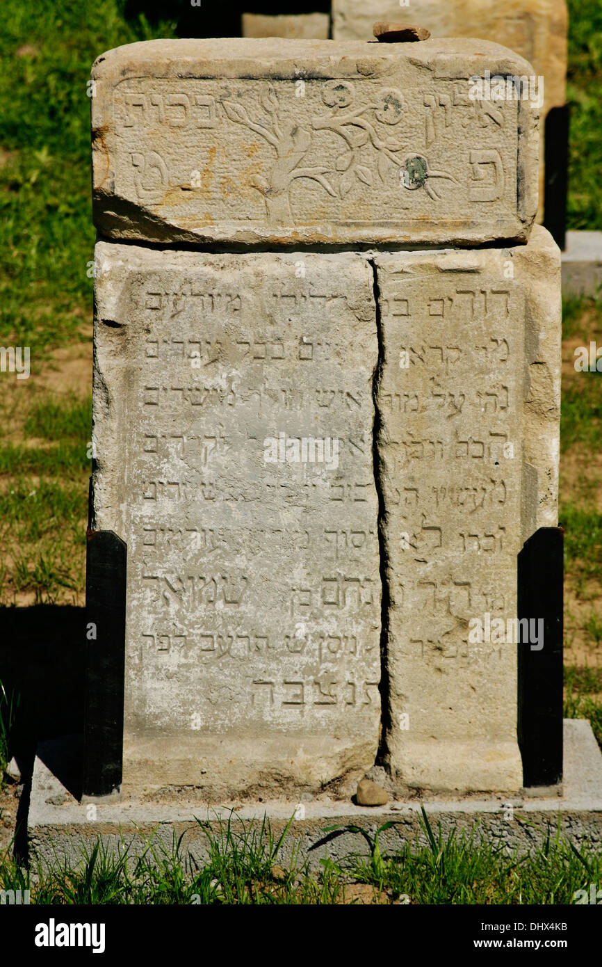 stolen Jewish headstones returned by locals to the newly re-consecrated cemetery of Brzostek Poland - Stock Image