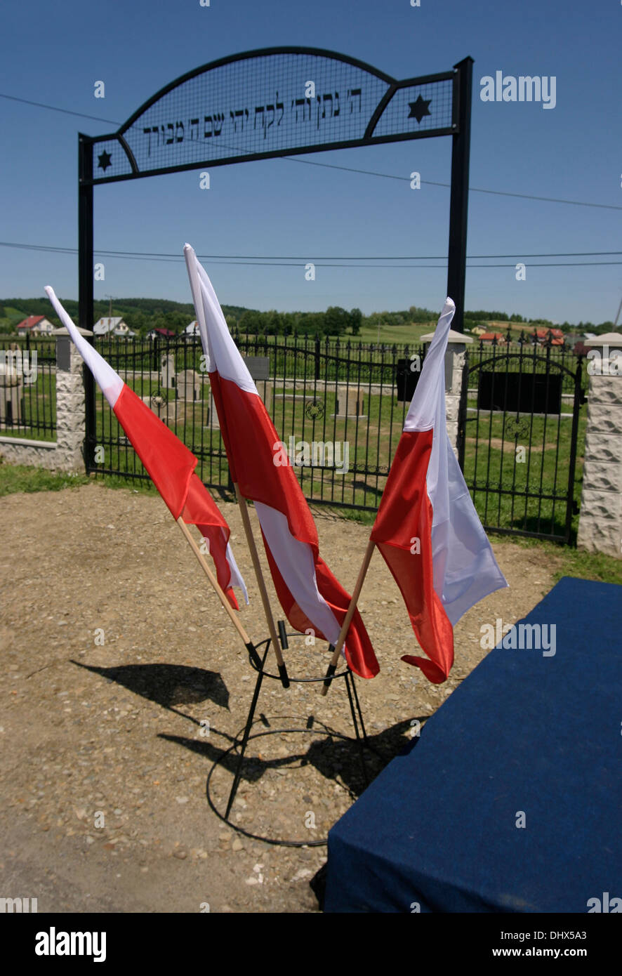 Polish flags fly outside the newly rebuilt and re-consecrated Brzostek's Jewish cemetery Poland - Stock Image