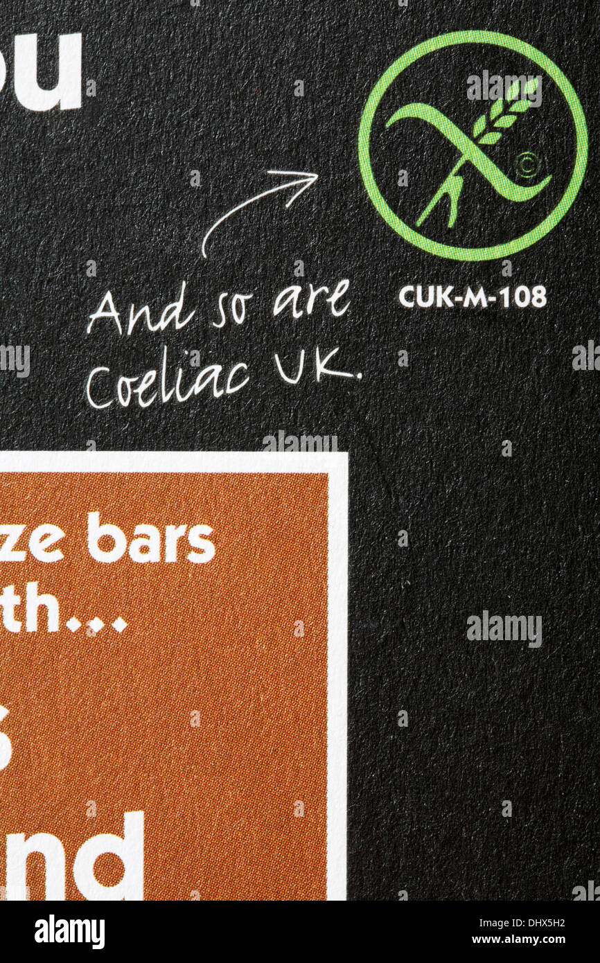 and so are Coeliac UK logo on packet of Eat Natural peanuts almonds and hazelnuts - Stock Image