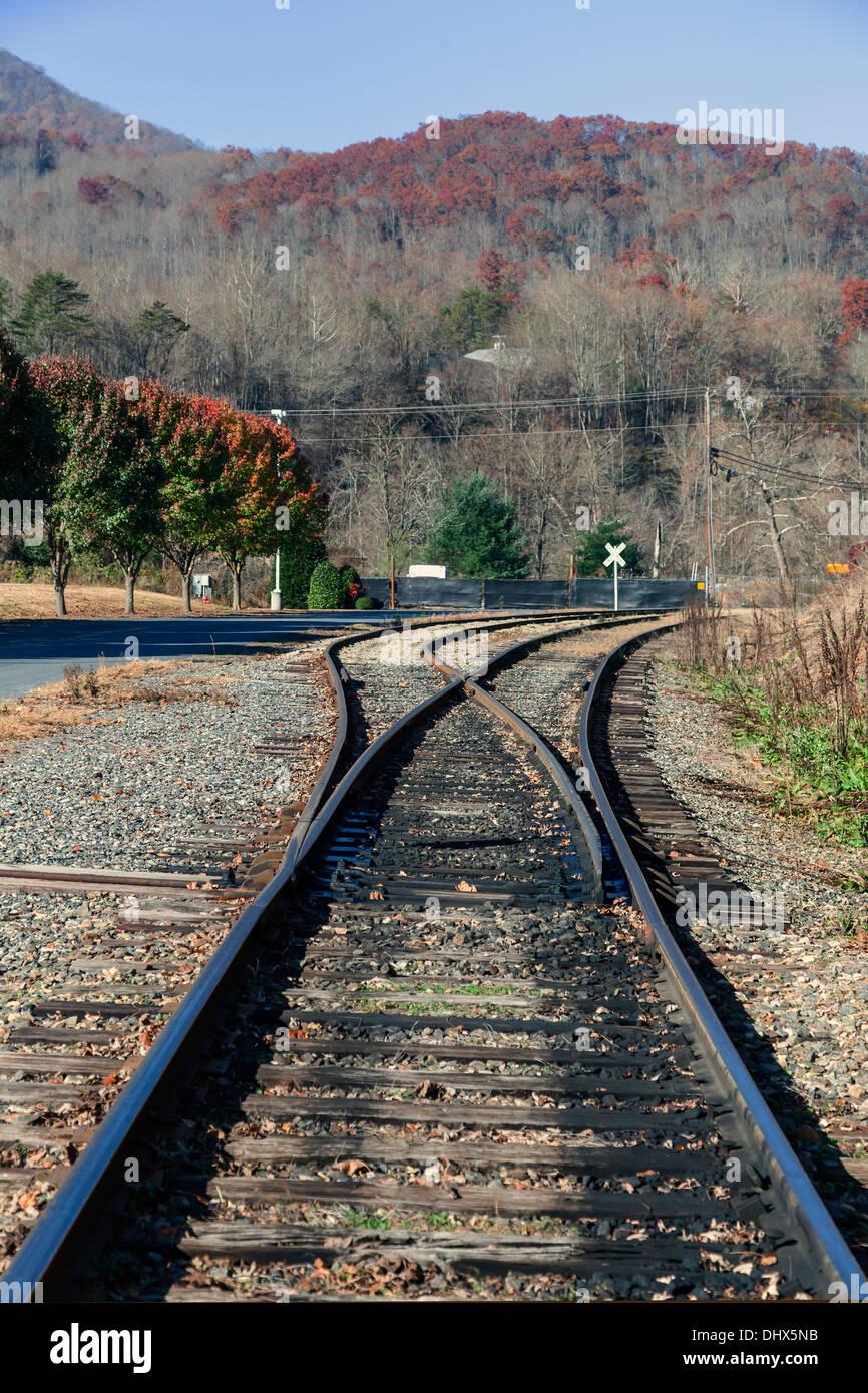 Railroad tracks and side spur in the Smoky Mountains near Dillsboro and Sylva, North Carolina, USA. - Stock Image