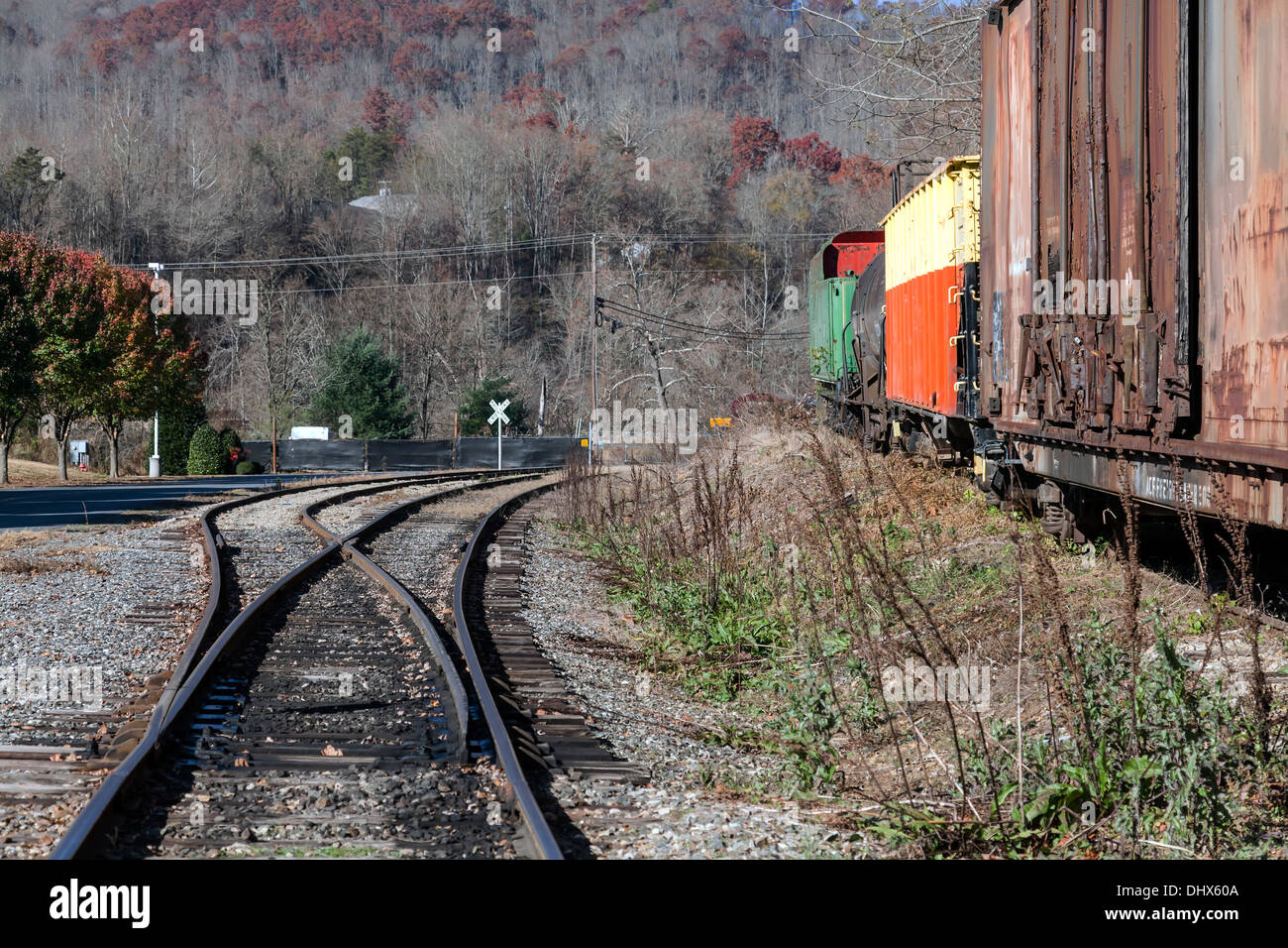 Unused railroad cars stored on a side spur in the Smoky Mountains near Dillsboro and Sylva, North Carolina, USA. - Stock Image
