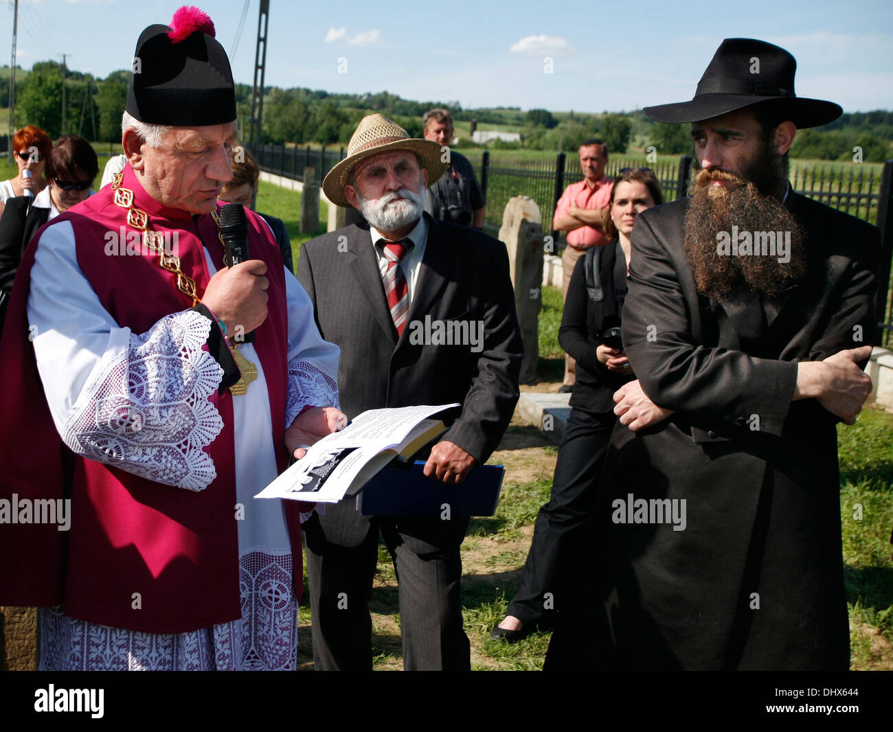 Deacon Brzostek Parish, Fr. Dr Jan Cebulak, Adam Bartosz,of Tarnow Committee for the Protection of Monuments of Jewish Culture. - Stock Image