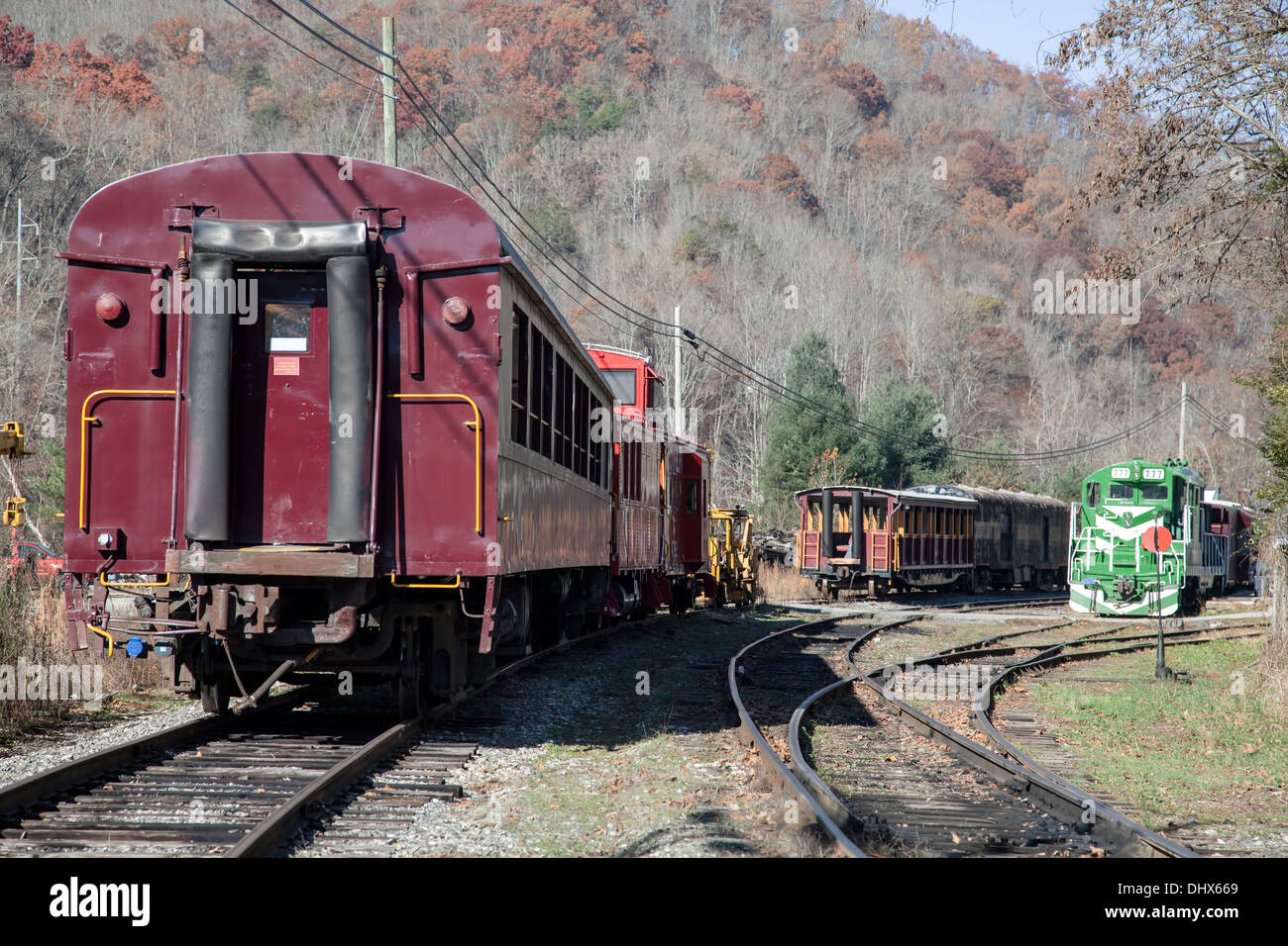 Unused railroad cars and engine stored on a side spur in train yard ...
