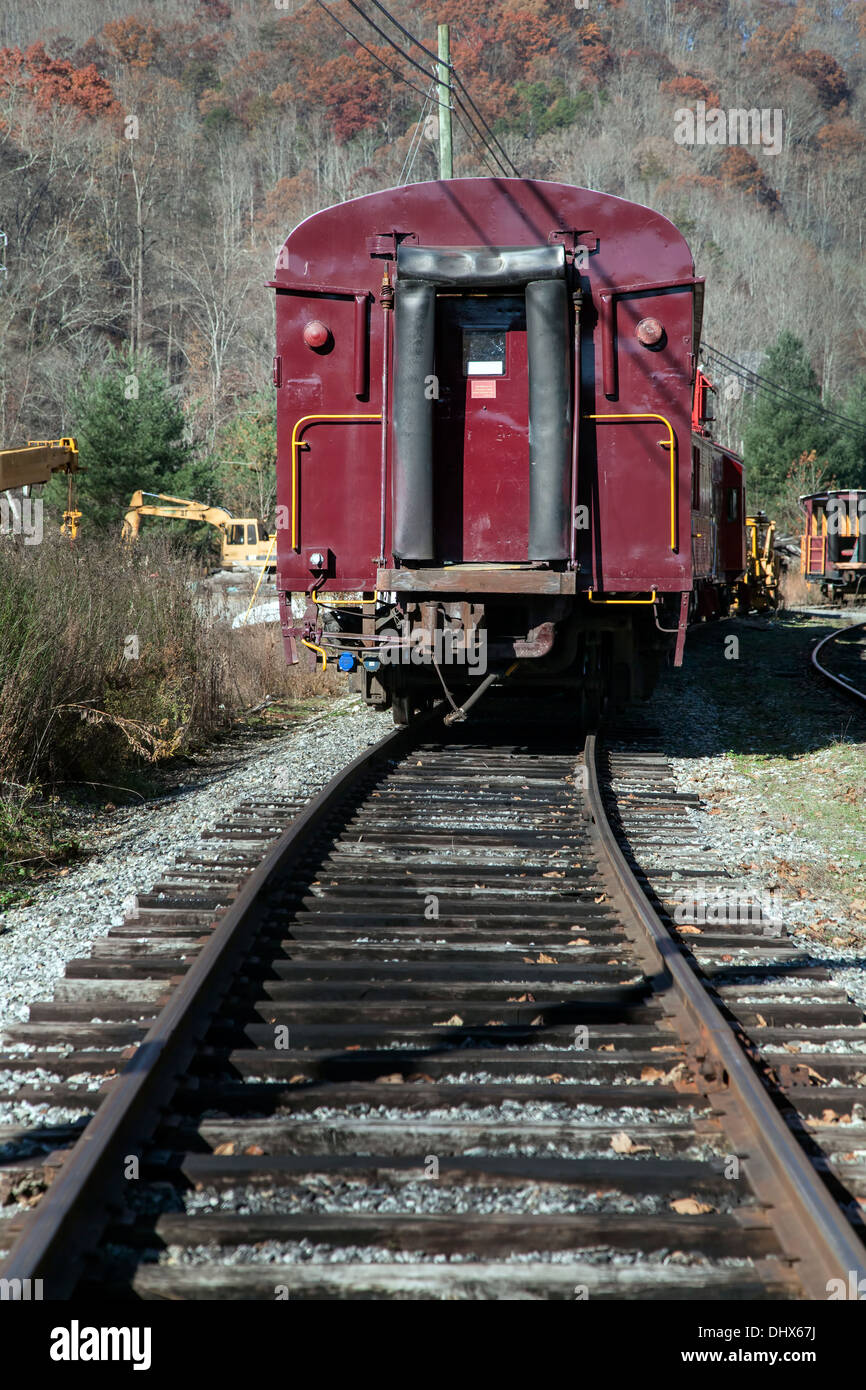 Unused railroad passenger car stored on a side spur near Dillsboro and Sylva, North Carolina. USA - Stock Image