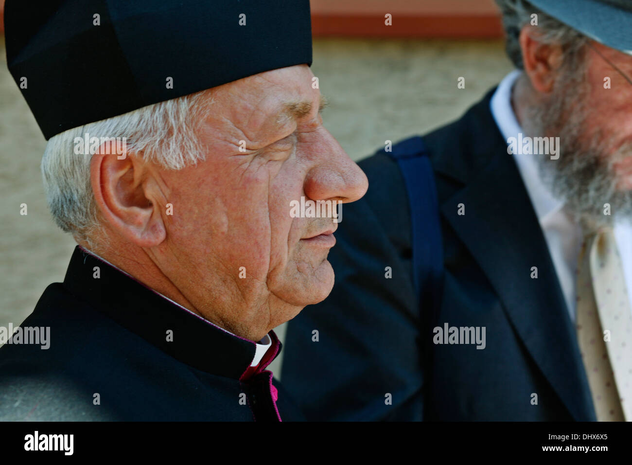 Deacon of the Brzostek Parish, Fr. Dr Jan Cebulak, at the re-consecration of Brzostek's Jewish cemetery - Stock Image