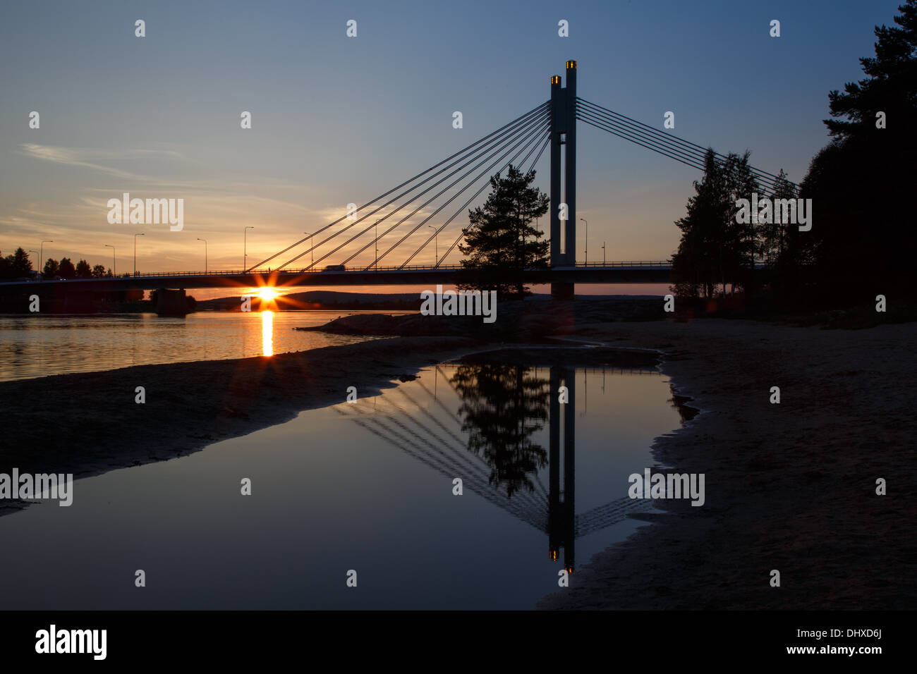 Midnight sun shining on Jätkänkynttilä (Lumberjack's Candle) bridge over the Kemijoki river in Rovaniemi by the Stock Photo