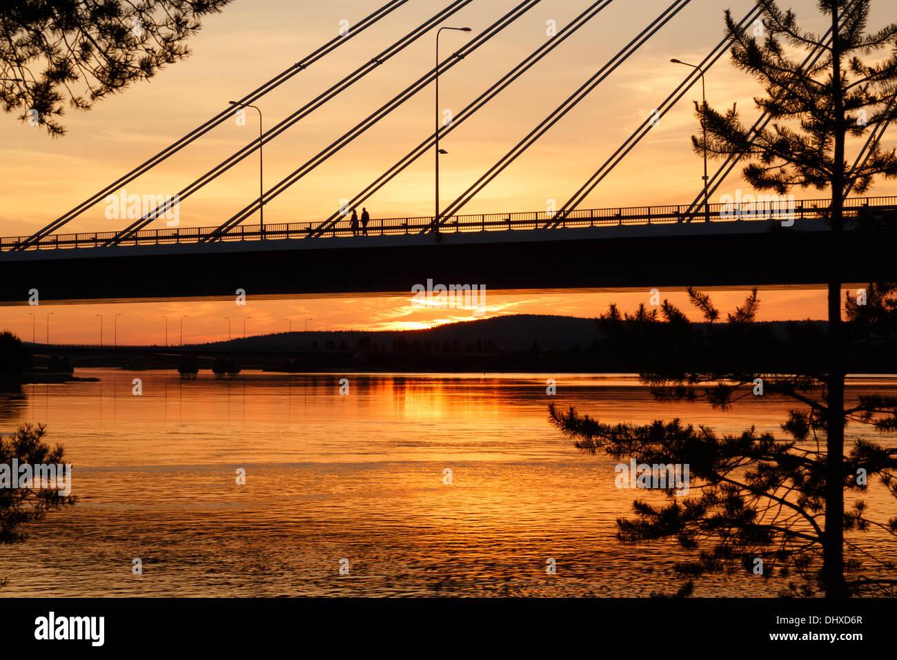 Midnight sun illuminating Jätkänkynttilä (Lumberjack's Candle) bridge over the Kemijoki river in Rovaniemi by the Stock Photo