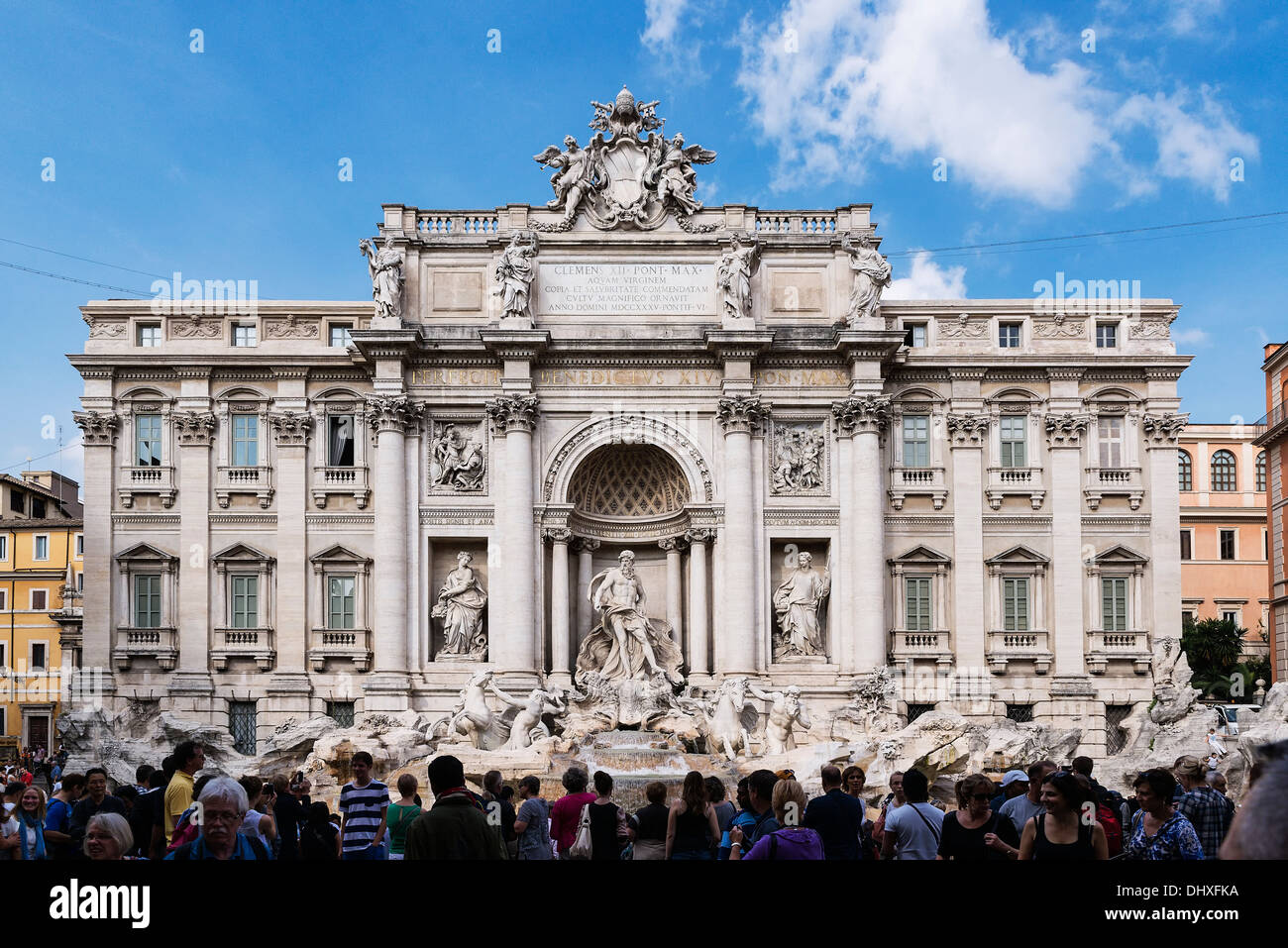 Tourists gather to admire the Trevi Fountain, Rome, Italy - Stock Image