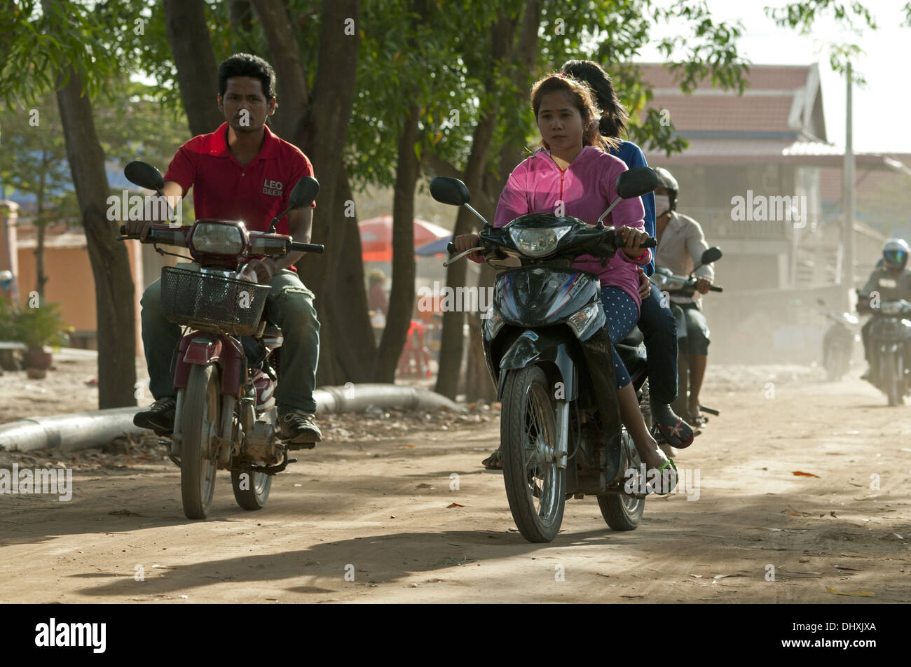 Young people riding motorbikes, Cambodia Stock Photo