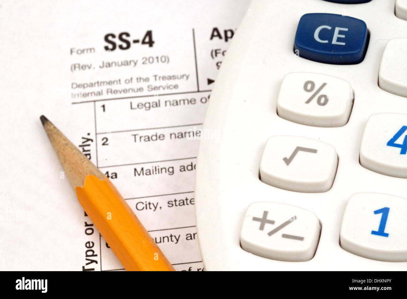 IRS Form SS-4 with tax prep tools Stock Photo: 62668115 - Alamy