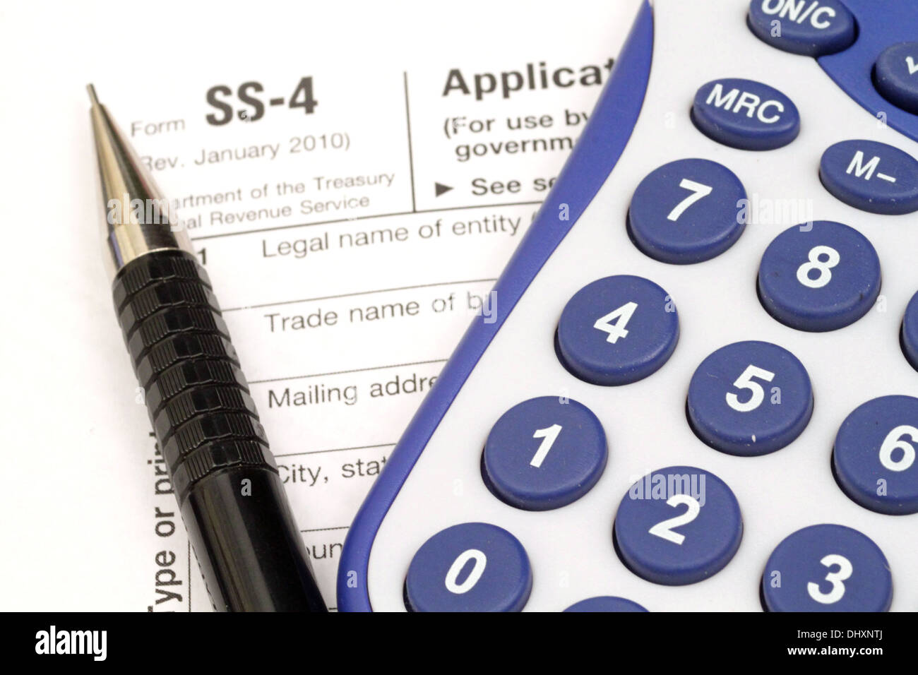 IRS Form SS-4 with tax prep tools Stock Photo: 62668162 - Alamy