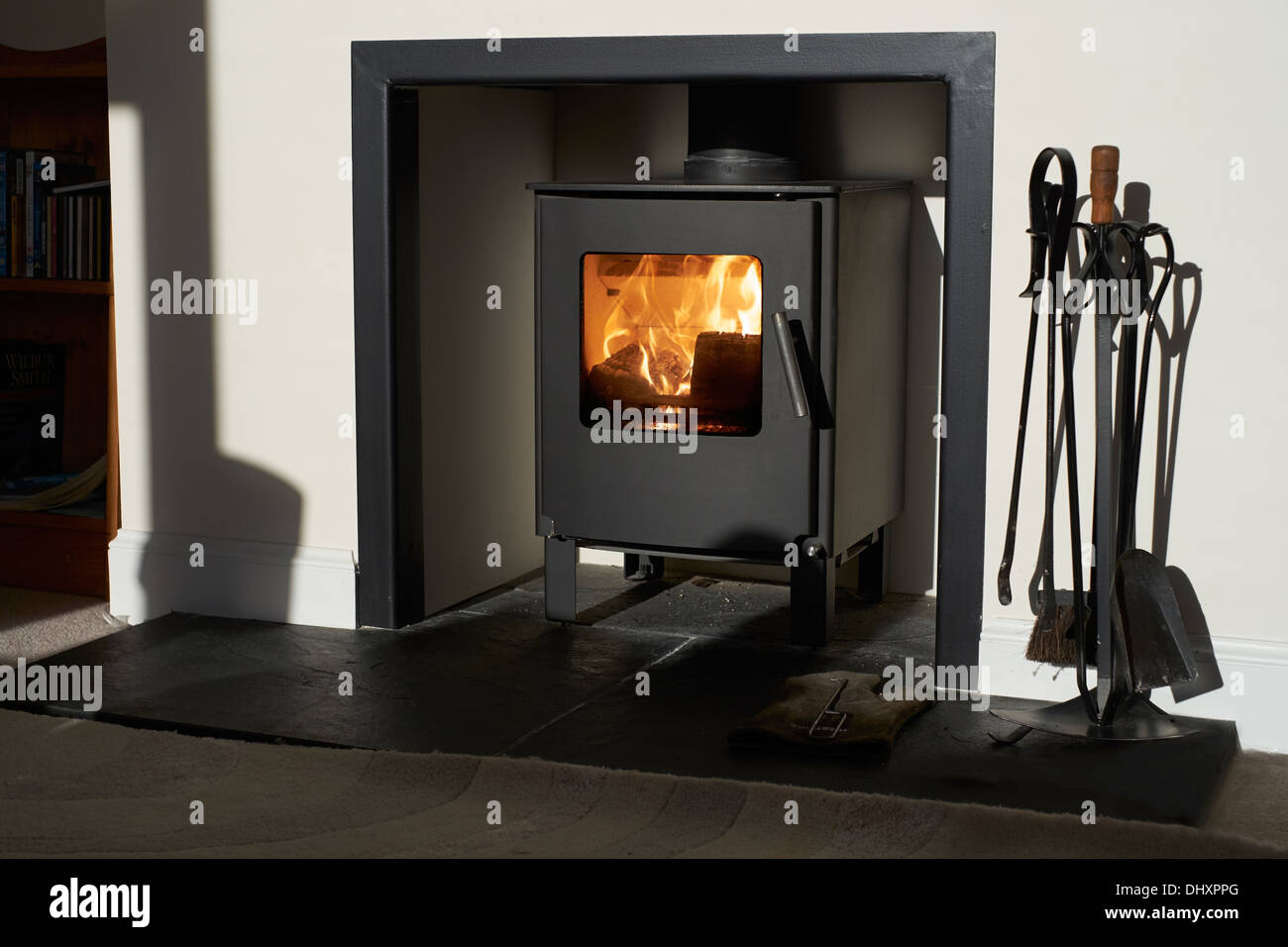 Wood burning stove, traditional heating system. Zero carbon footprint - Stock Image