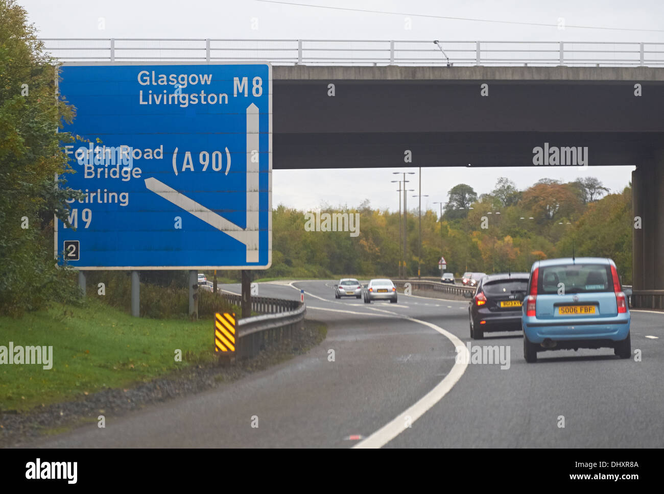 Cars approaching the Forth Road Bridge turning on the M8 to Glasgow, Scotland,UK. - Stock Image
