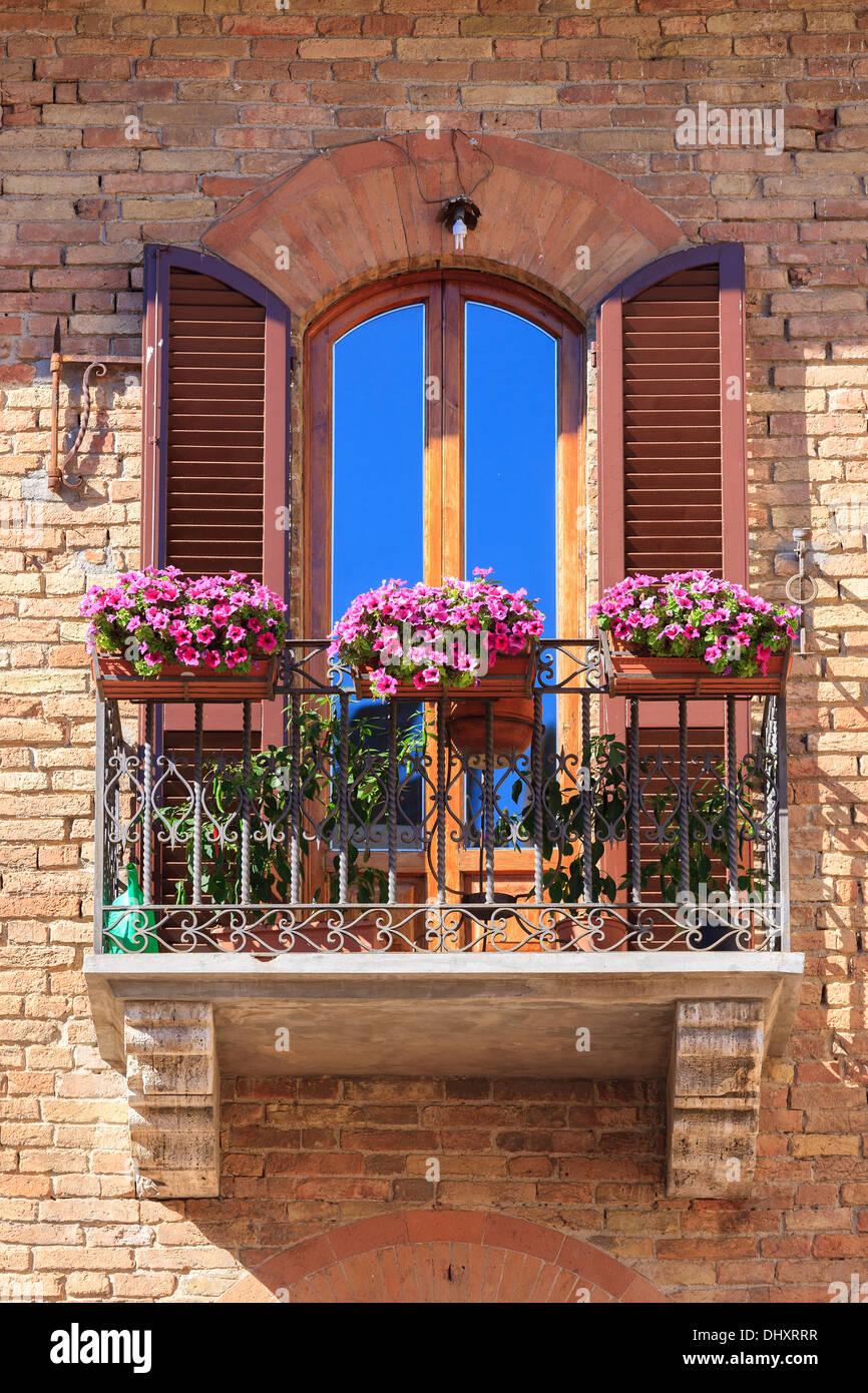 Italian Balcony With Flowers In San Gimignano A Medieval