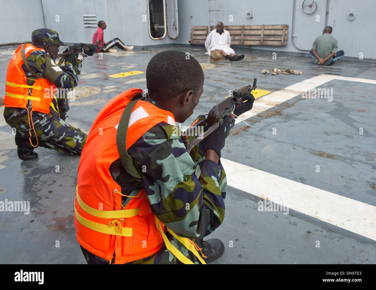 DJIBOUTI, Djibouti (Nov. 14, 2013) - Uganda People's Defence Force members guard simulated detainees on a vessel during Exercise Cutlass Express 2013 in the Gulf of Tadjoura near Djibouti. Exercise Cutlass Express 2013 is a multinational maritime exercise - Stock Image