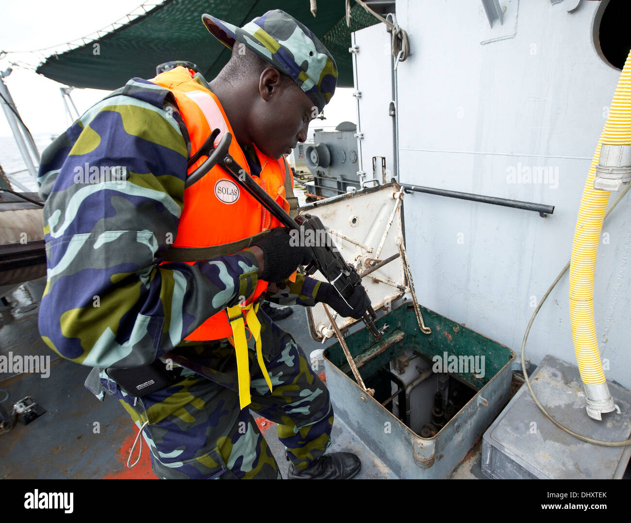 DJIBOUTI, Djibouti (Nov. 14, 2013) - A Uganda People's Defence Force member searches a target vessel during Exercise Cutlass Express 2013 in the Gulf of Tadjoura near Djibouti. Exercise Cutlass Express 2013 is a multinational maritime exercise in the wate - Stock Image