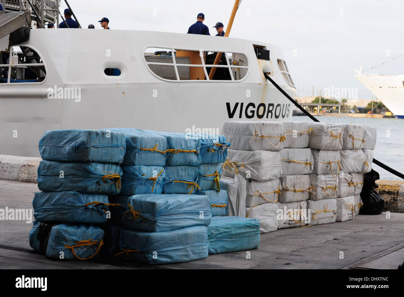 Forty-one bales of cocaine are stacked behind the Coast Guard Cutter Vigorous during a drug offload at Port Everglades, Fla., Nov. 15, 2013. The drugs are the results of two interdictions carried out as part of Operation Martillo. Coast Guard photo by Pet - Stock Image