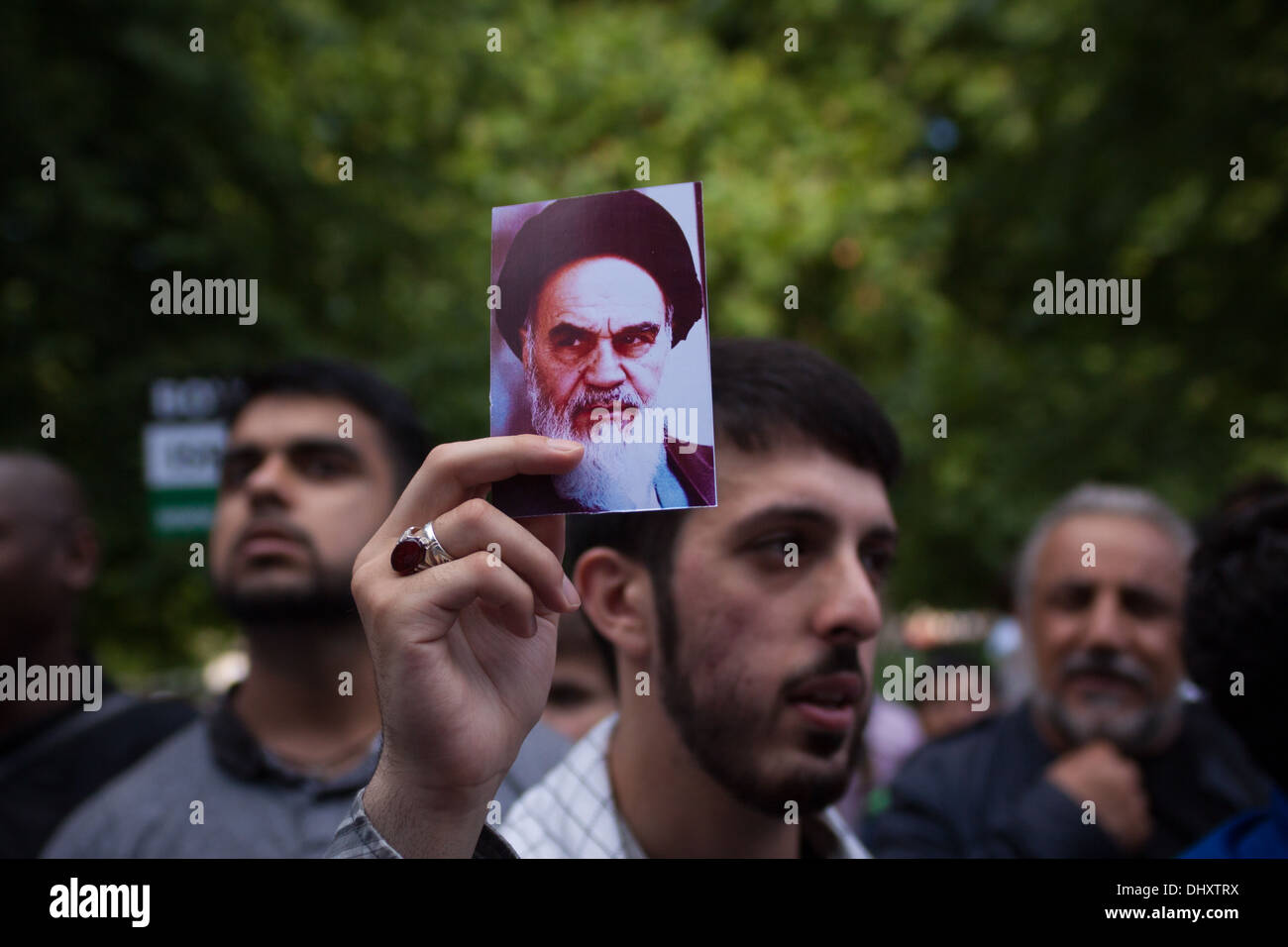 A man holds a photo of former Iranian leader Ruhollah Khomeini at the 2013 Al-Quds day demonstration, London. - Stock Image