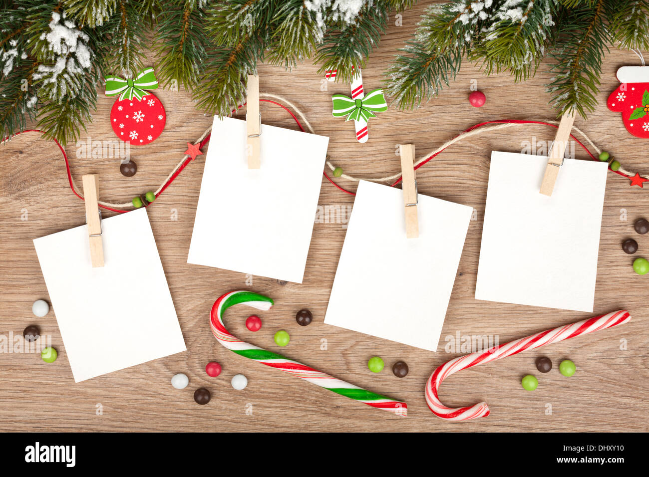 Blank Christmas Photo Frames With Fir Tree And Decor Stock Photo