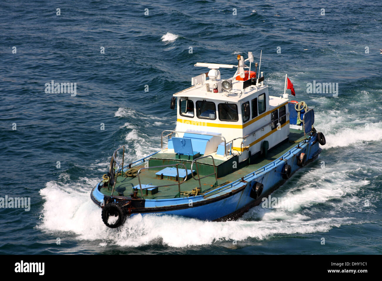 Tugboat on the waters of the Golden Horn, Istanbul, Republic of Turkey Stock Photo