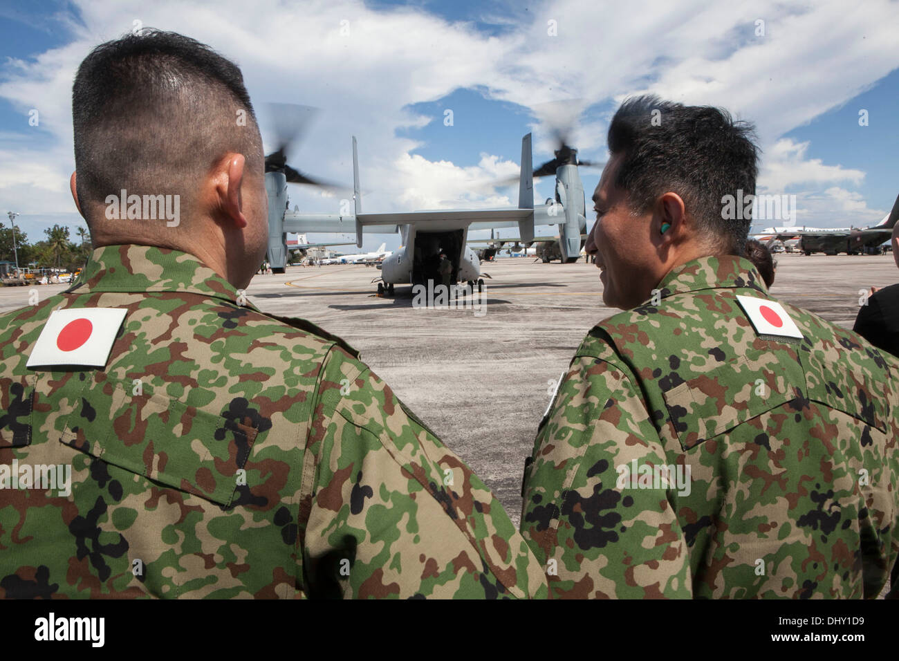 Japan Ground Self-Defense Force members wait to board an MV-22B Osprey aircraft Nov. 14 as part of Operation Damayan. The aircraft, JGSDF members and other relief personnel later landed in Tacloban to provide support to the Philippine government who is sp - Stock Image