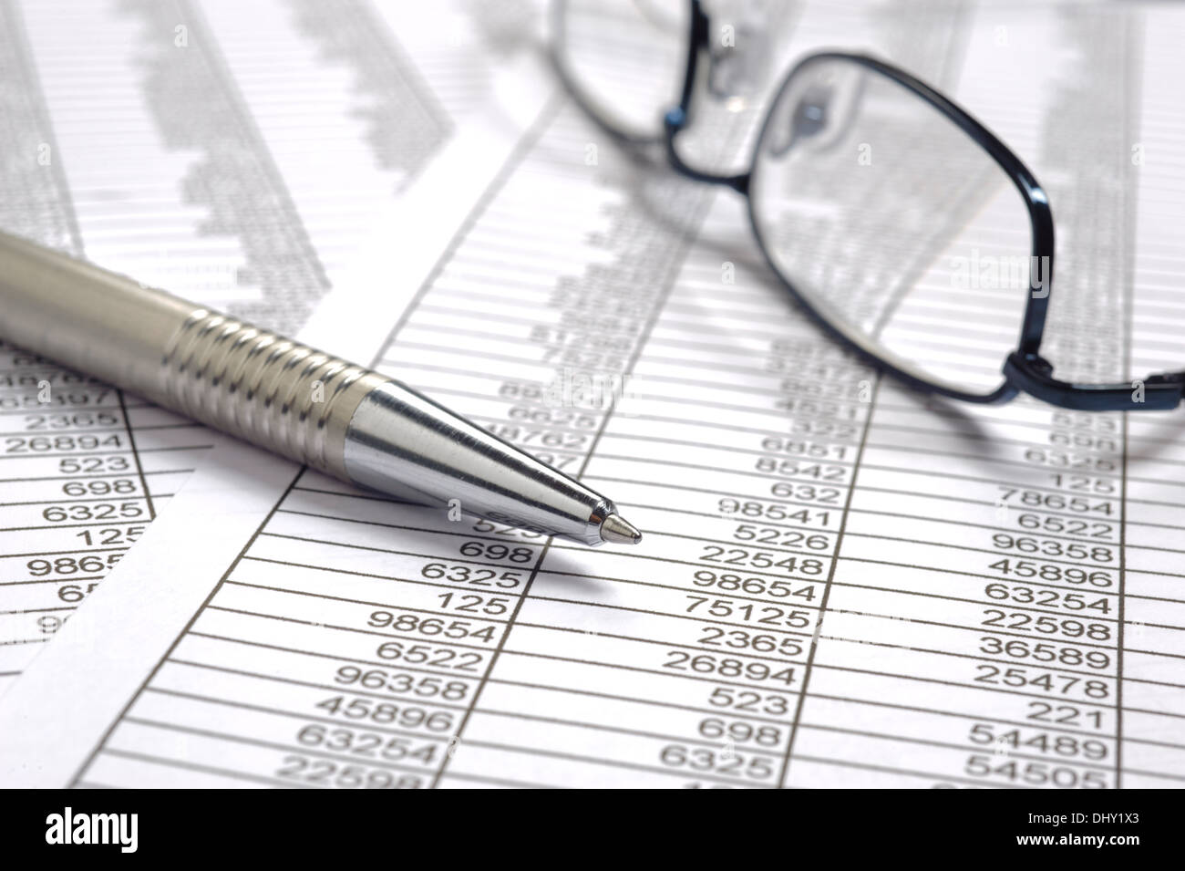 finance business calculation with glasses, chart and pen - Stock Image