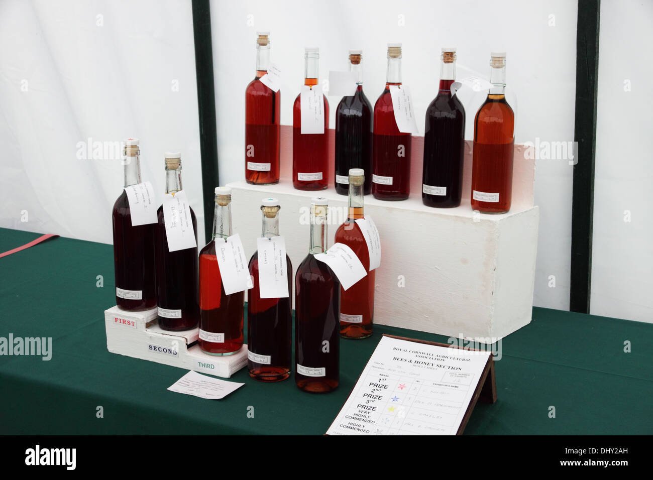 Bottles of homemade wine with prize winning labels attached.