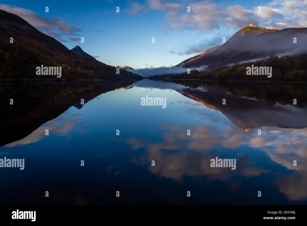 Dramatic early morning reflection and mist on Loch Leven, Scotland, UK - Stock Image