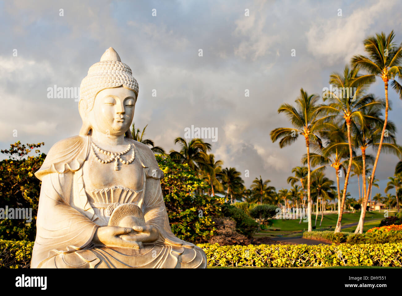 Prayer at Sunset in Paradise with Buddha - Stock Image