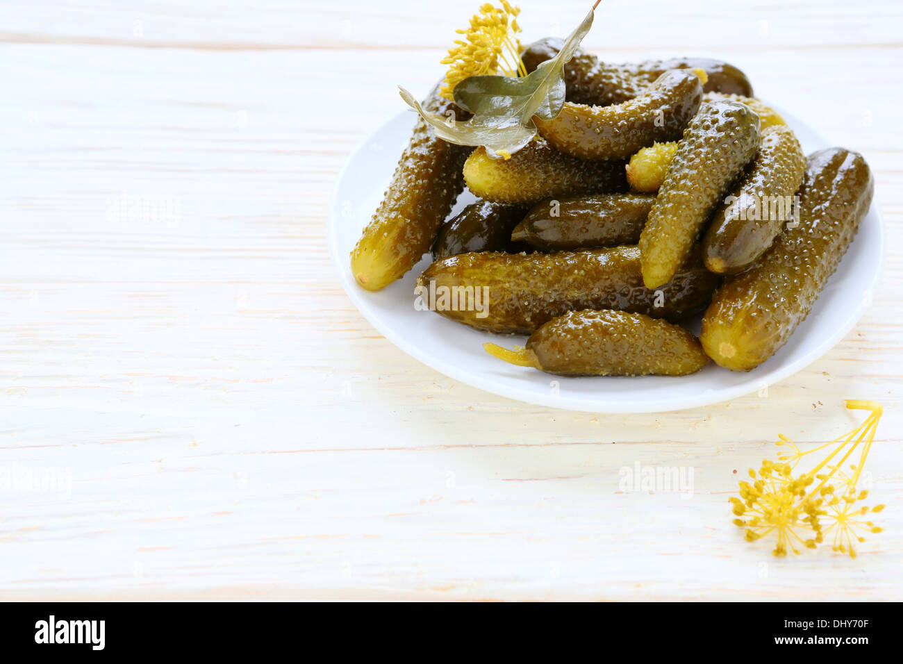 pickled cucumbers on a white plate, food - Stock Image