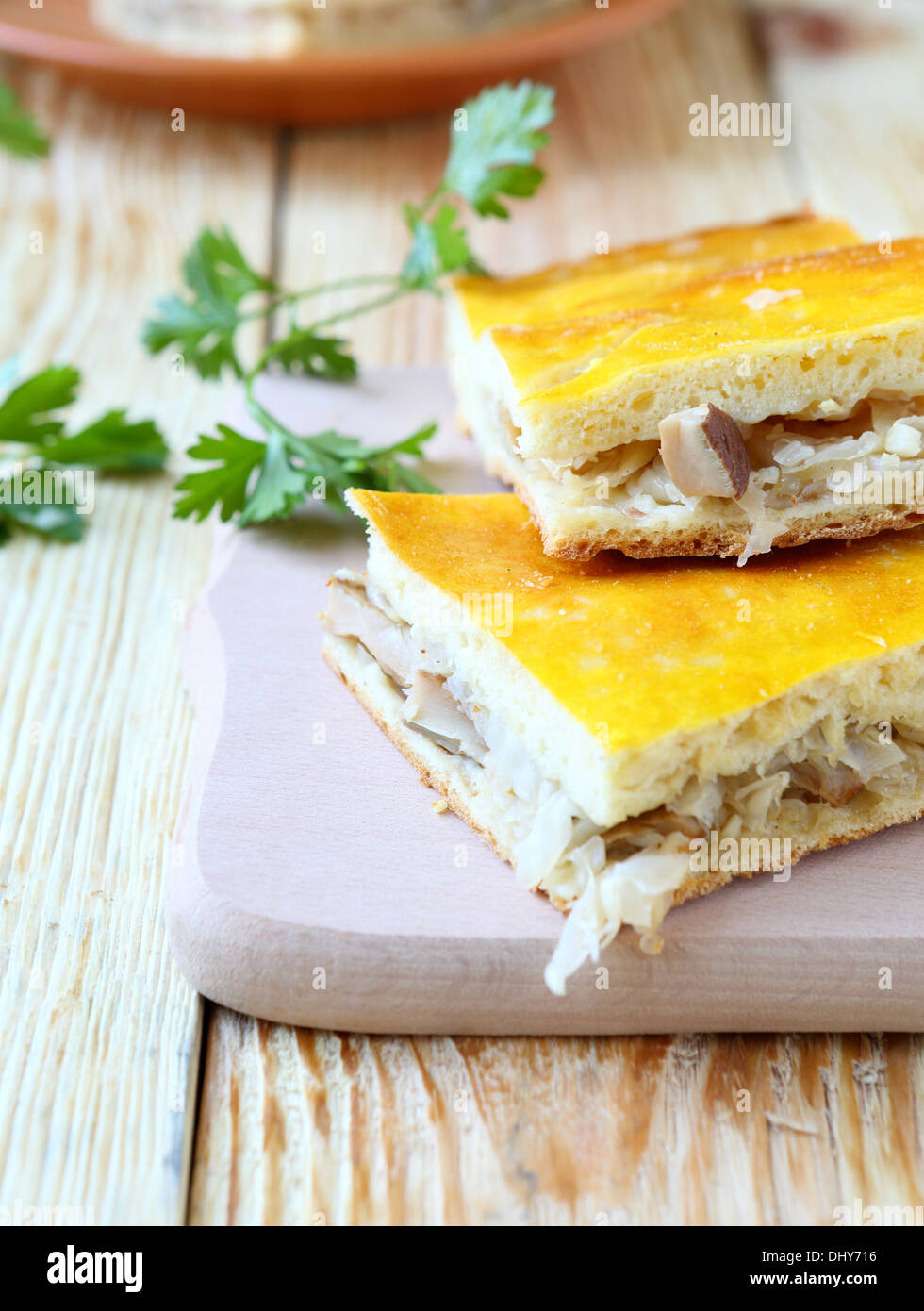 slices of cake with fried cabbage, food - Stock Image